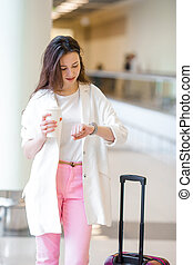 caucasian tourist young woman an airport waiting for her aircraft