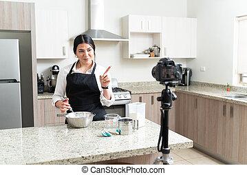 Caucasian Vlogger Making At Tutorial About Making Cake