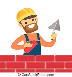 Caucasian white bricklayer building a brick wall.
