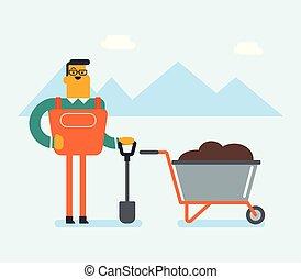 Caucasian white farmer standing with a shovel.