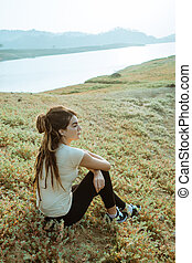 caucasian woman alone sitting