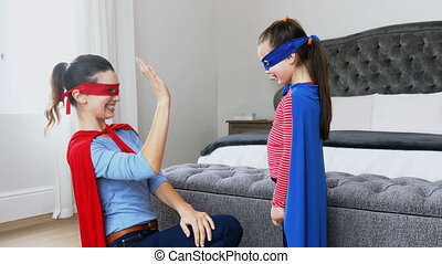 Caucasian woman and daughter wearing a cape with word Stay ...