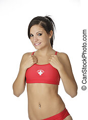 Beautiful and sexy Caucasian woman posing in a red lifeguard swinsuit