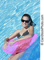 Beautiful Caucasian woman enjoying a day at the pool