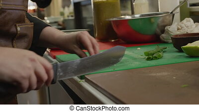 Caucasian woman cutting vegetables