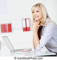 Caucasian woman daydreaming
