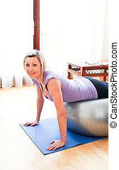 Caucasian woman doing exercice at home