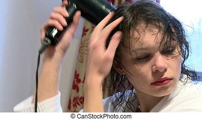 Caucasian woman drying her hair