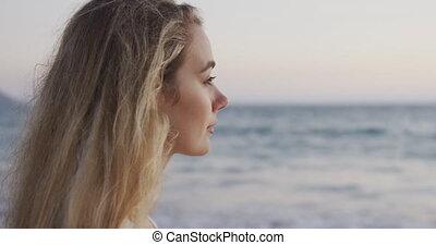 Caucasian woman enjoying her time seaside