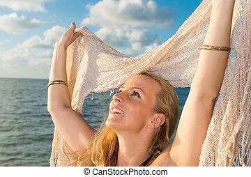 Caucasian woman enjoys the beach