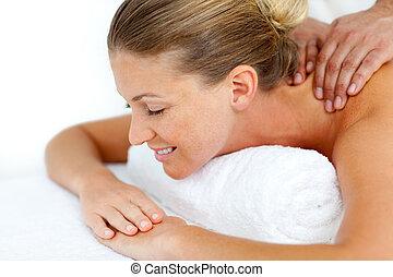 Caucasian woman having a back massage