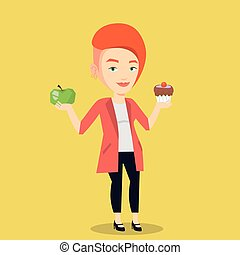 Woman choosing between apple and cupcake.
