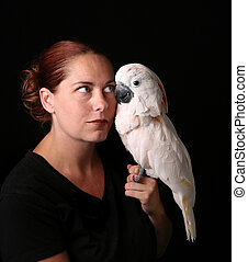 Caucasian Woman Holding Her Pet Moluccan Cockatoo
