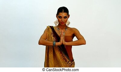 Caucasian woman posing for photographer in Indian dress