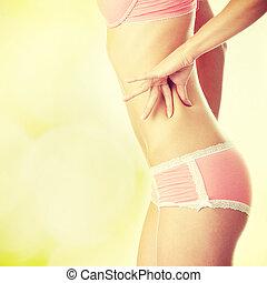 Caucasian woman in pink underwear