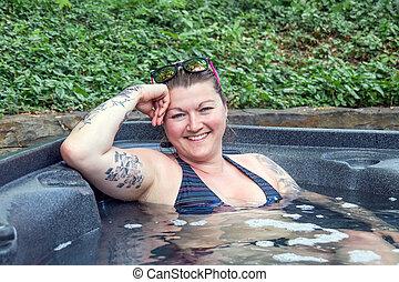 caucasian woman in the hot tub - caucasian woman relaxing in...