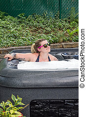 caucasian woman in the hot tub