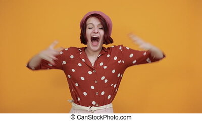 Caucasian woman looking at camera smiling with open arms for hug