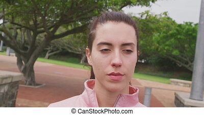 Caucasian woman looking away in park - Portrait of a ...