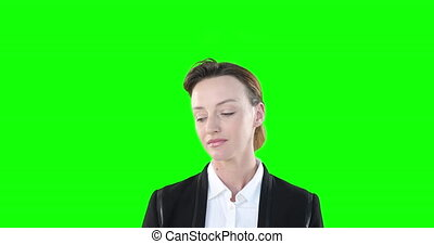 Caucasian woman looking up on green background - Portrait of...