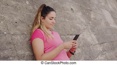Caucasian woman on her smartphone - Side view close up of a ...