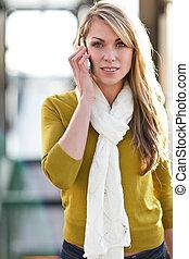 Caucasian woman on the phone - A beautiful caucasian woman...