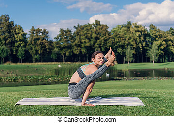 caucasian woman performing yoga pose