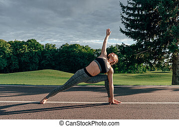 caucasian woman practicing yoga pose