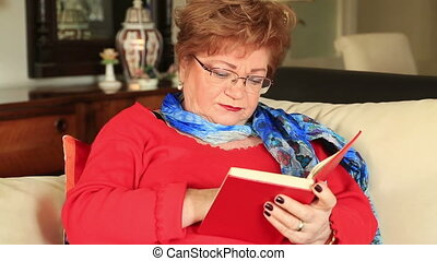 Caucasian woman reading book