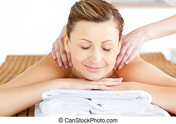 caucasian woman receiving a massag