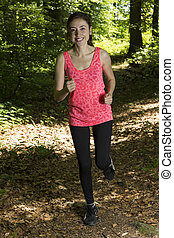 Caucasian woman running in the forest