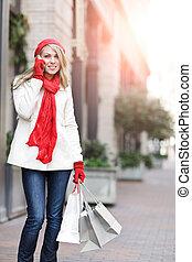 Caucasian woman shopping - A shopping caucasian woman ...