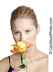 caucasian woman smelling rose
