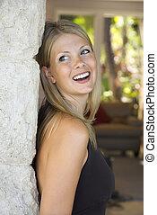 Caucasian woman smiling.