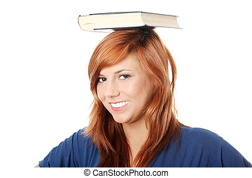 Caucasian woman (student) with book on her head