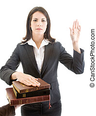 Caucasian Woman Swearing on Stack of Bibles Isolated White Backg