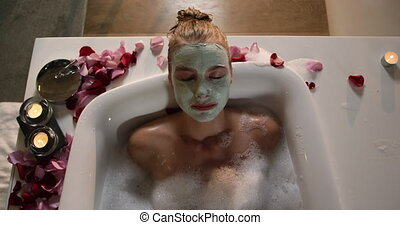 Caucasian woman taking bath in hotel - Front view of a ...