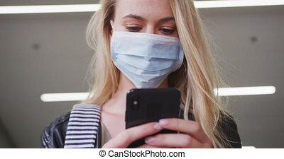 Caucasian woman wearing a coronavirus Covid19 mask - ...