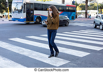 Caucasian woman wearing a protective mask and coughing out ...