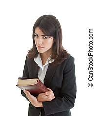 Caucasian woman with mournful expression holding a bible.  Isolated on white background.