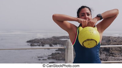Caucasian woman working out on the docks - Front view close ...