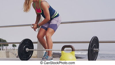 Caucasian woman working out on the docks