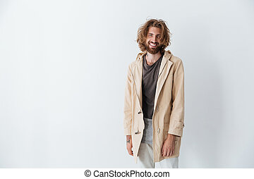 Caucasian young happy bearded man standing isolated