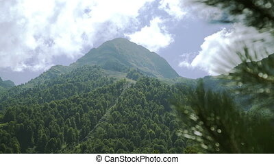 Caucasus Mountain landscape with mountain peaks covered with...