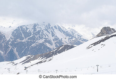 Caucasus mountains, cable car in the mountains covered with snow