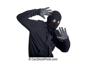 Caught burglar - Catch the burglar concept, thief with...