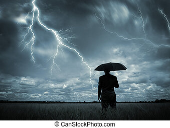Caught in the Storm - A businessman holding an umbrella in a...