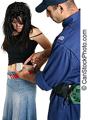 Caught Shoplifting - A security guard removes a concealed...