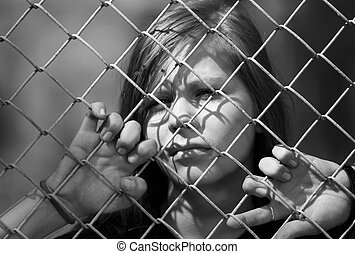 caught - The young girl behind a lattice