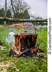 cauldron on campfire